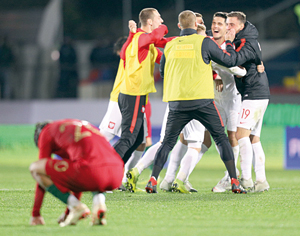 Poland players react after the victory against Portugal 1-3 during their Euro 2019 Sub-21 play-off match held at Municipal Engº Manuel Branco Teixeira Stadium, in Chaves, north of Portugal, 20 November 2018. PEDRO SARMENTO COSTA/LUSA