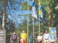 DR-Hastear das bandeiras na praia fluvial de Secarias